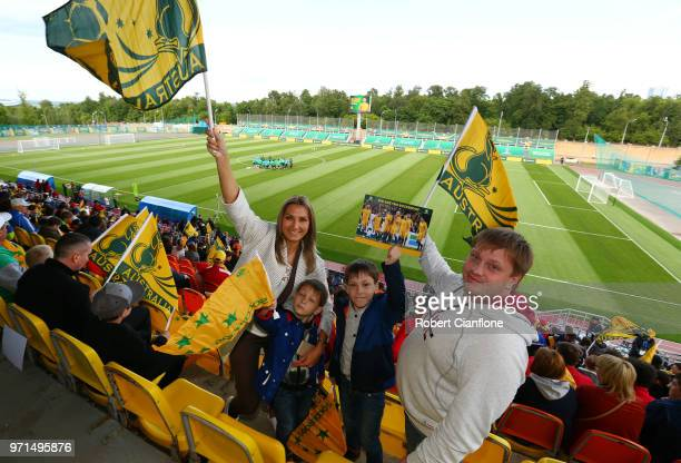 Fans enjoy the atmosphere waving flags in support during an Australian Socceroos training session ahead of the FIFA World Cup 2018 in Russia at...