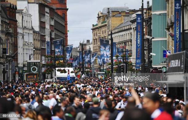 Fans enjoy the city centre atmosphere prior to the UEFA Champions League Final between Juventus and Real Madrid on June 3 2017 in Cardiff Wales