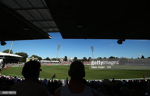 Fans enjoy the cricket during game three of the One Day International Series between Australia and South Africa at Manuka Oval on November 19 2014 in...