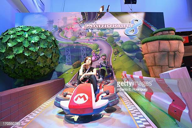 Fans enjoy the Nintendo Mariokart 8 display at the E3 Gaming and Technology Conference at the Los Angeles Convention Center on June 11 2013 in Los...