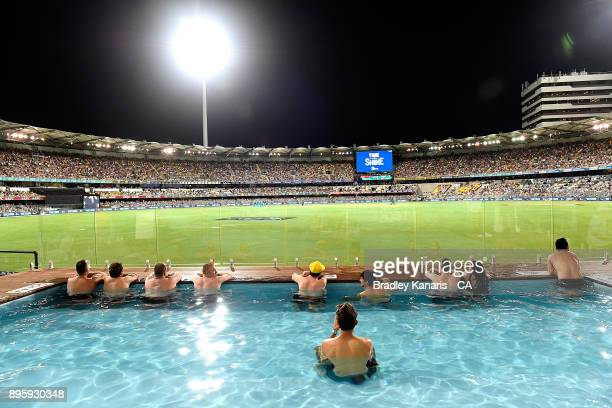 Fans enjoy the pool as they watch the Big Bash League match between the Brisbane Heat and the Melbourne Stars at The Gabba on December 20 2017 in...
