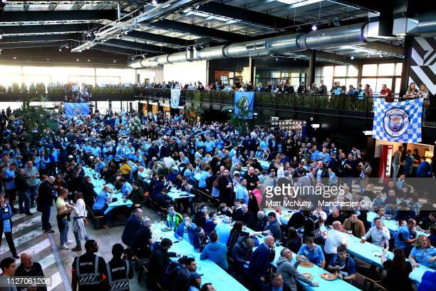 Fans enjoy the pre match atmosphere ahead of the Carabao Cup Final between Chelsea and Manchester City at Wembley Stadium on February 24 2019 in...