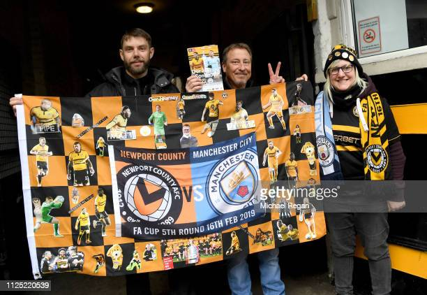 Fans enjoy the pre match atmosphere ahead of the FA Cup Fifth Round match between Newport County AFC and Manchester City at Rodney Parade on February...
