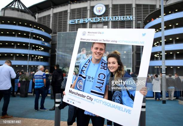 Fans enjoy the pre match atmosphere prior to the Premier League match between Manchester City and Huddersfield Town at Etihad Stadium on August 19...