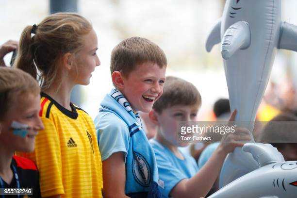 Fans enjoy the pre match atmosphere prior to the Premier League match between Manchester City and Huddersfield Town at Etihad Stadium on May 6 2018...
