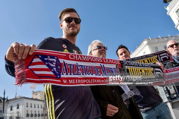 Fans enjoy the prematch atmosphere ahead of the UEFA Champions League Round of 16 First Leg match between Club Atletico de Madrid and Juventus at...