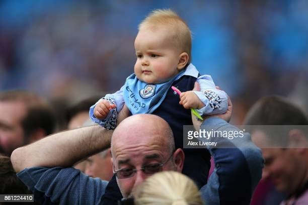 Fans enjoy the prematch atmosphere prior to the Premier League match between Manchester City and Stoke City at Etihad Stadium on October 14 2017 in...