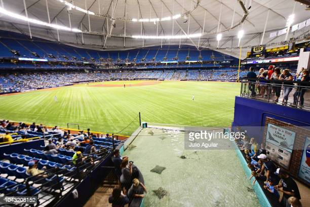 Fans enjoy the stingray tank during the sixth inning of a game against the Tampa Bay Rays and the Toronto Blue Jays on September 29 2018 at Tropicana...
