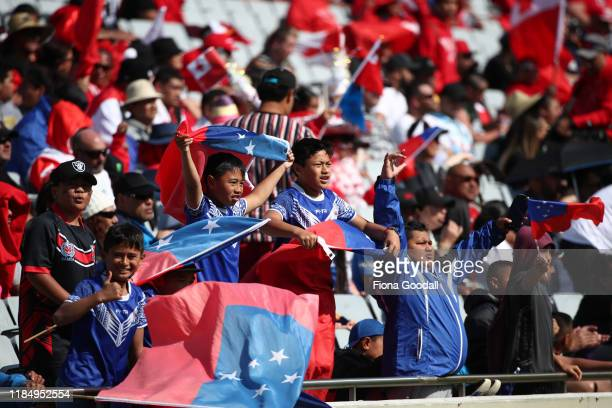 Fans enjoy the sun ahead of 1the International Rugby League Test Match between the New Zealand Kiwis and the Great Britain Lions at Eden Park on...