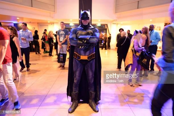 """Fans enjoy the various SDCC museum activities and displays during """"The Gathering"""" ahead of the induction ceremony during The Batman Experience..."""