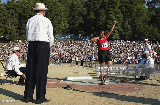 Fans enjoy the view as Ana Pouhila of Tonga prepares to make an attempt during the women's shot put qualifying round on August 18, 2004 during the...