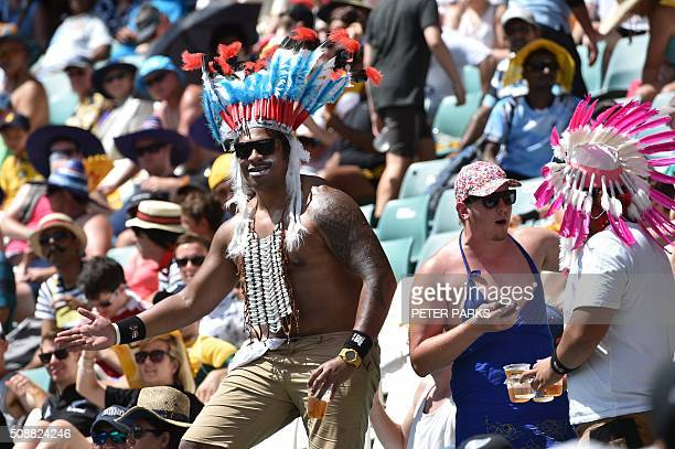 Fans enjoy themselves at the Sydney Sevens rugby union tournament in Sydney on February 7 2016 AFP PHOTO / Peter PARKS IMAGE RESTRICTED TO EDITORIAL...