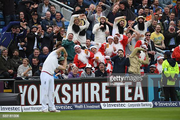 Fans enjoy themselves on the Western Terrace with the England 12th man during day three of the 1st Investec Test match between England and Sri Lanka...