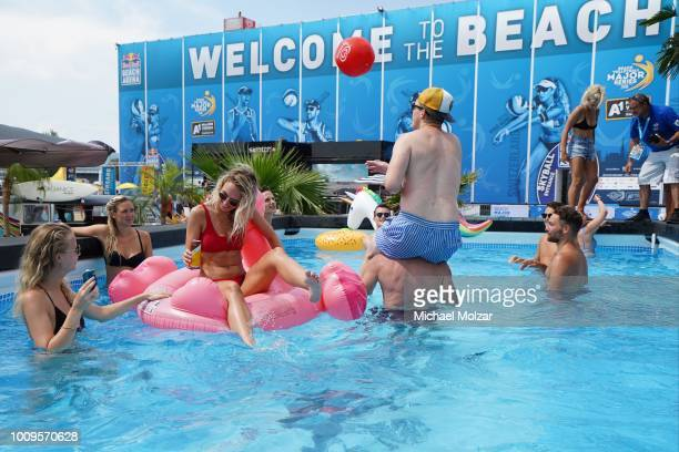 Fans enjoying the pool offered on the area on day two of the FIVB Beach Volleyball World Tour Major Series Vienna on Danube Island on August 2 2018...