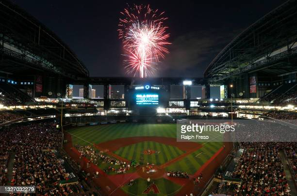 Fans enjoys a post-game fireworks display celebrating the Fourth of July following the MLB game between the Arizona Diamondbacks and San Francisco...