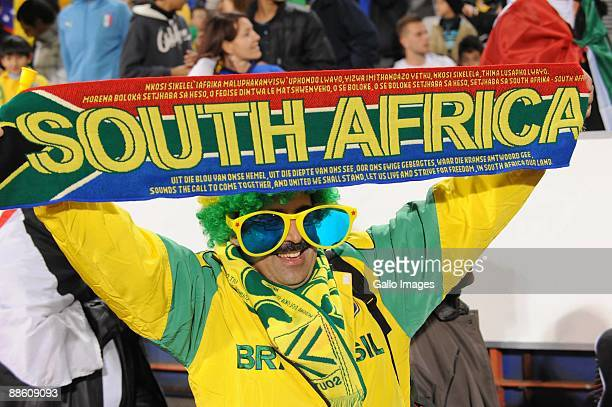 A fans enjoys the match during the FIFA Confederations Cup match between Italy and Brazil at Loftus Versfeld on June 21 2009 in Pretoria South Africa
