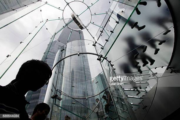 Fans enter Apple Inc's new flagship store in Shanghai China on 10 July 2010 Apple is one of the few multinationals that truly dominates its market in...