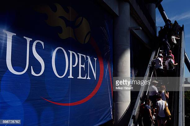 Fans enter Arthur Ashe Stadium on Day Five of the 2016 US Open at the USTA Billie Jean King National Tennis Center on September 2 2016 in the...