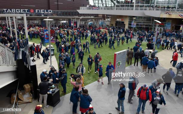 Fans enter Gate 34 of Target Field before the Opening Day game between the Minnesota Twins and the Cleveland Indians on March 28, 2019 in...