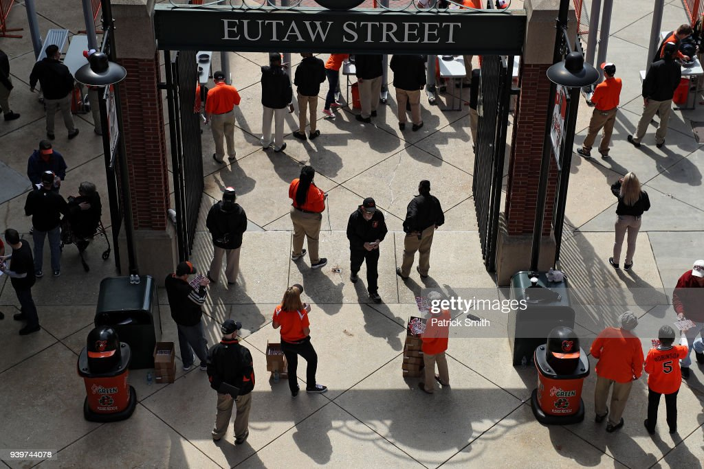 Fans enter the ballpark before the Minnesota Twins play the Baltimore Orioles in their Open Day game at Oriole Park at Camden Yards on March 29, 2018 in Baltimore, Maryland.