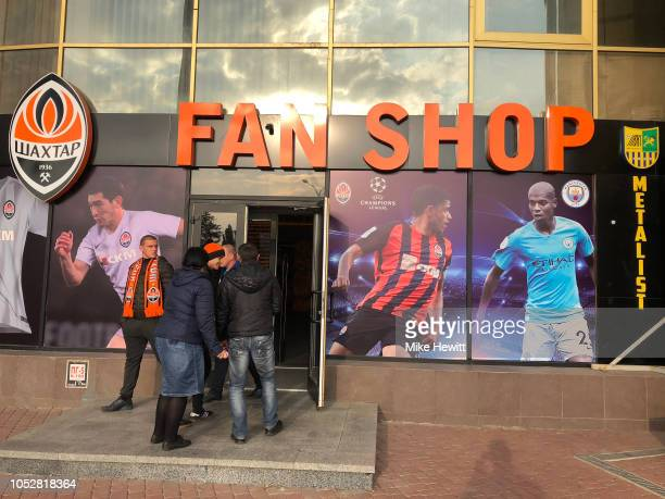 Fans enter the fan shop prior to the Group F match of the UEFA Champions League between FC Shakhtar Donetsk and Manchester City at Metalist Stadium...