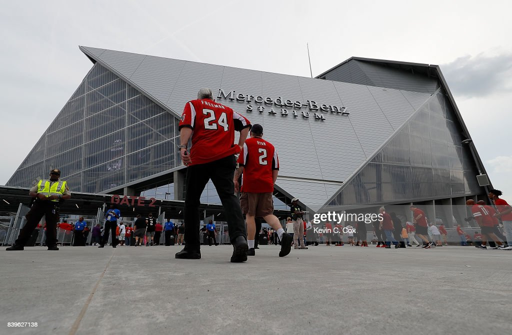 Fans enter the gates prior to the game between the Atlanta Falcons and the Arizona Cardinals at Mercedes-Benz Stadium on August 26, 2017 in Atlanta, Georgia.