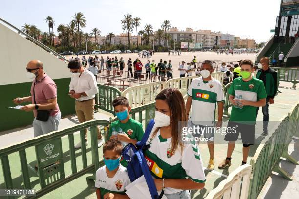 Fans enter the stadium prior to the La Liga Santander match between Elche CF and Athletic Club at Estadio Martinez Valero on May 22, 2021 in Elche,...