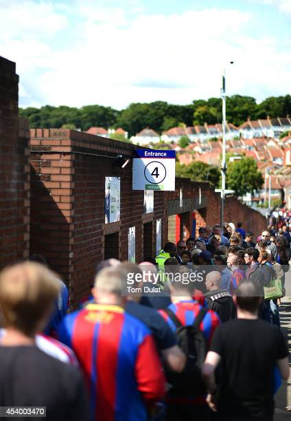 Fans enter the stadium prior to the Premiere League match between Crystal Palace and West Ham United at Selhurst Park on August 23 2014 in London...