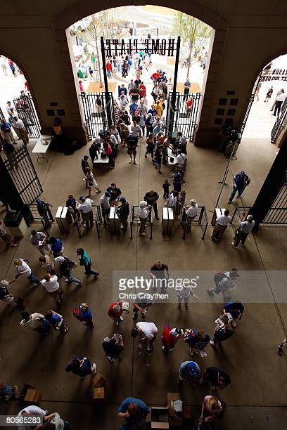 Fans enter the stadium to watch the Baltimore Orioles and the Texas Rangers on April 8, 2008 at Rangers Ballpark in Arlington, Texas