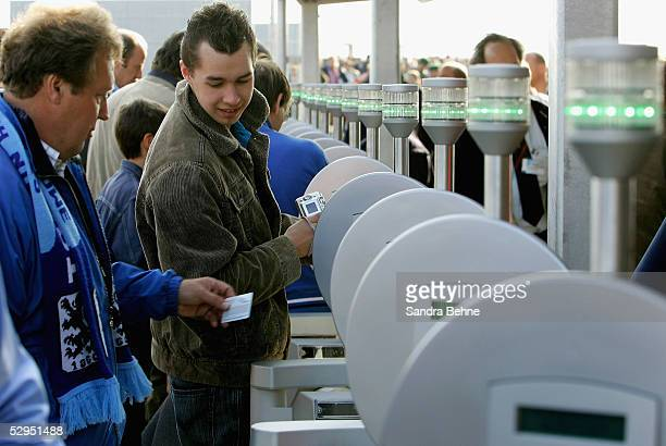 Fans enter the stadium with electronic tickets for the exhibtion match between the traditional teams of 1860 Munich and Bayern Munich at the Allianz...
