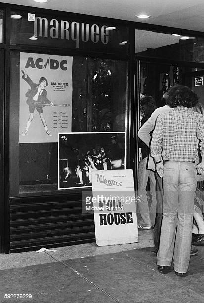 Fans entering the Marquee Club on Wardour Street London before a concert by hard rock group AC/DC 11th August 1976