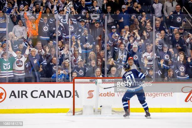 Fans erupt in the stands as Kyle Connor of the Winnipeg Jets scores a third period empty net against the Vegas Golden Knights at the Bell MTS Place...