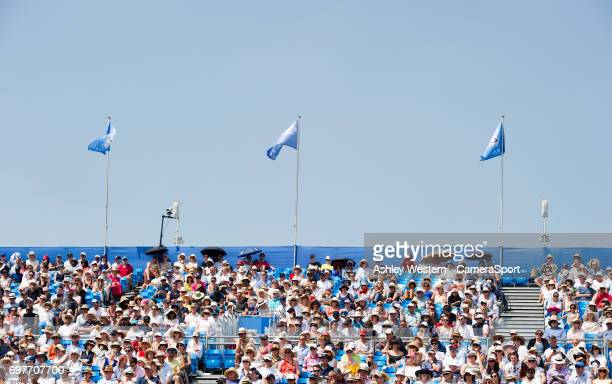 Fans feeling the heat as temperatures soared during Day 1 of the Aegon Championships 2017 at Queens Club on June 19 2017 in London England