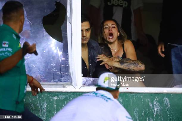 Fans fight against each other during the quarterfinals second leg match between Leon and Tijuana as part of the Torneo Clausura 2019 Liga MX at Leon...