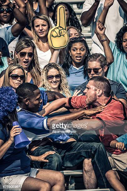 Fans fighting at the American Football match