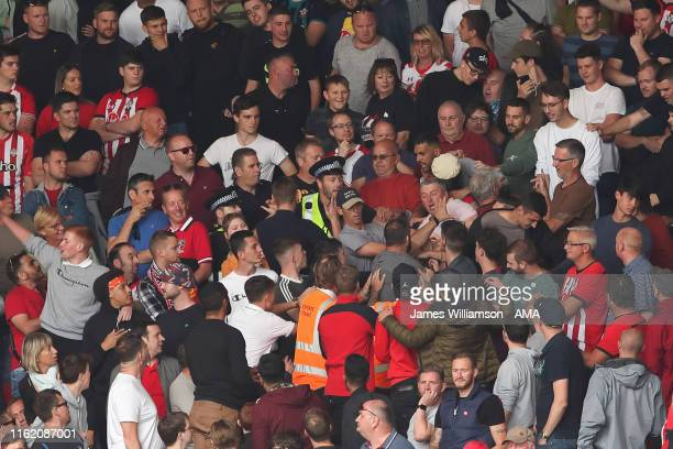 Fans fighting in the stands during the Premier League match between Southampton FC and Liverpool FC at St Mary's Stadium on August 17 2019 in...