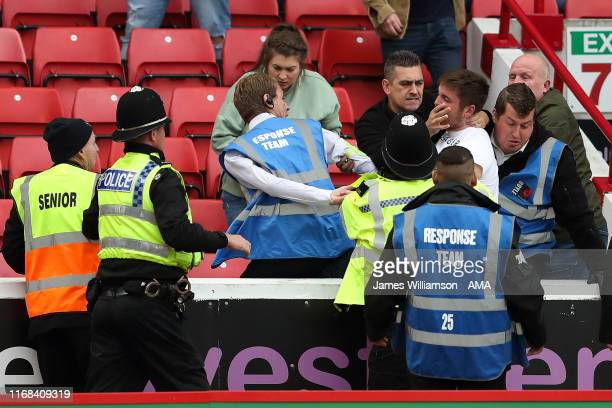 Fans fighting in the stands during the Sky Bet Championship match between Barnsley and Leeds United at Oakwell Stadium on September 15, 2019 in...