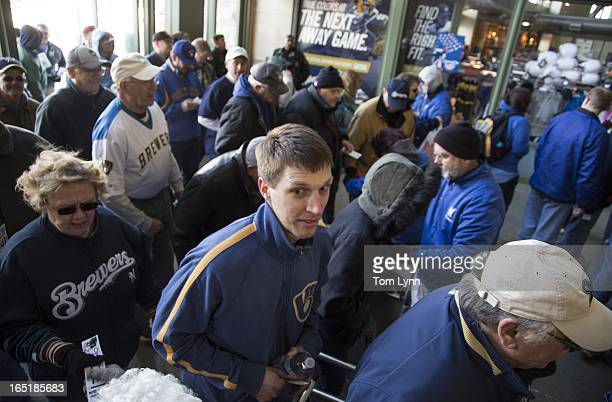 Fans file through the turnstiles as the stadium opens for the game between the Milwaukee Brewers and Colorado Rockies on opening day at Miller Park...