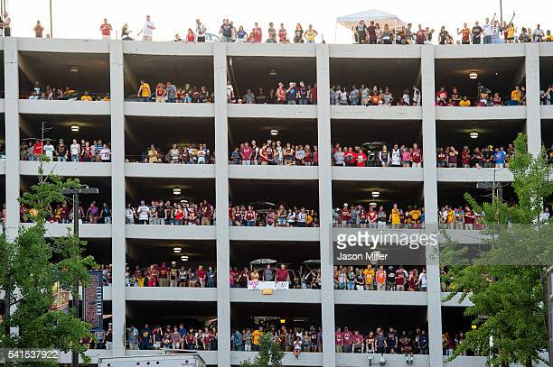 Fans fill a parking garage with in view of Quicken Loans Arena during the Cleveland Cavaliers NBA Finals Game Seven watch party on June 19 2016 in...