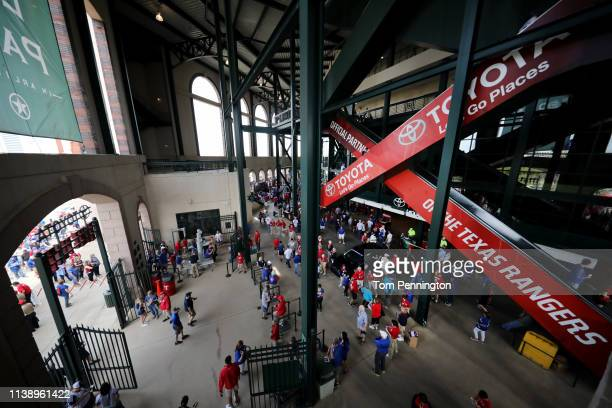 Fans fill the concourse before the Texas Rangers take on the Chicago Cubs during Opening Day at Globe Life Park in Arlington on March 28 2019 in...