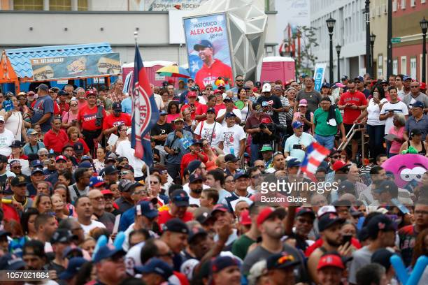 Fans fill the square as they wait for Red Sox manager Alex Cora to take the stage at his hometown with the World Series trophy Red Sox manager Alex...