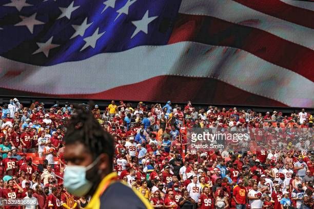 Fans fill the stands prior to the U.S. National Anthem before the Los Angeles Chargers play against the Washington Football Team at FedExField on...