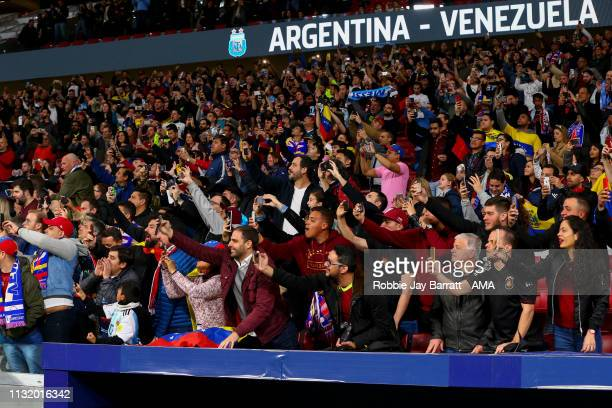 Fans films on their mobile phones during the International Friendly match between Argentina and Venezuela at Estadio Wanda Metropolitano on March 22...