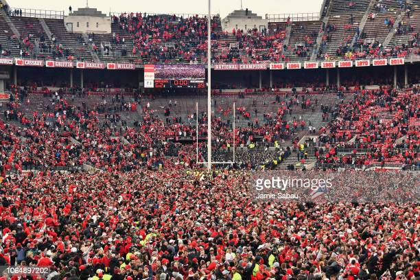 Fans flood the field at Ohio Stadium after the Ohio State Buckeyes defeated the Michigan Wolverines 6239 on November 24 2018 in Columbus Ohio