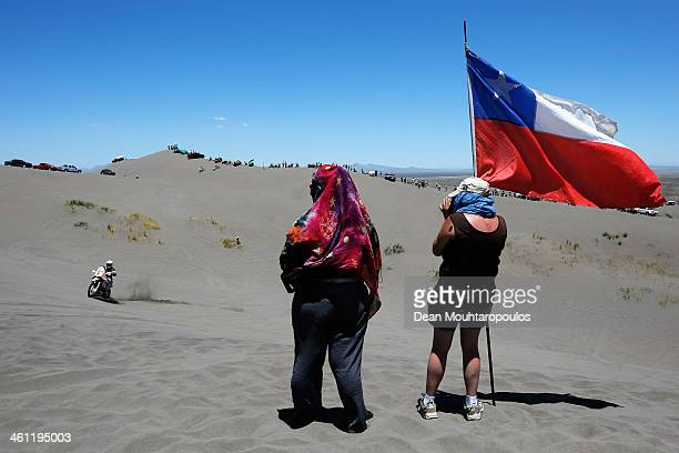 Fans flying the Chile Flag watch Kevin Muggleton of the USA for Honda Redverz as he competes on Day 2 of the Dakar Rally 2014 on January 6 2014 in...