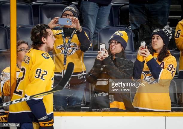 Fans focus their cameras on Ryan Johansen of the Nashville Predators during warmups prior an NHL game against the Arizona Coyotes at Bridgestone...