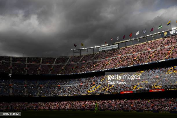 Fans follow the action from their seats keepìng social distance measures during the La Liga Santader match between FC Barcelona and Getafe CF at Camp...