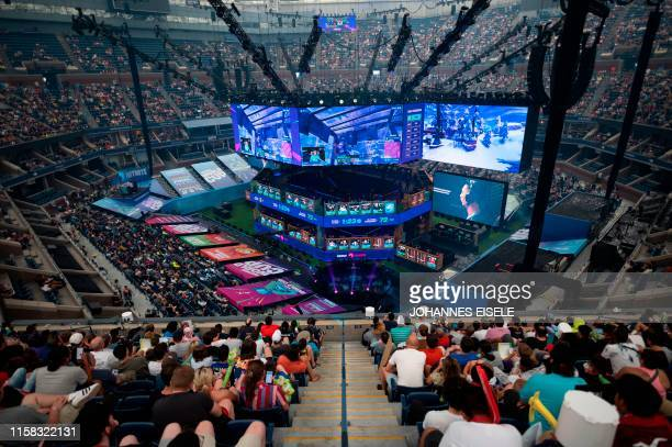 Fans follow the final of the Solo competition at the 2019 Fortnite World Cup July 28 2019 inside of Arthur Ashe Stadium in New York City