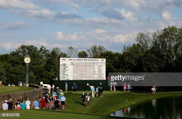 Fans follow the group of Shanshan Feng of China and Jeongeun6 Lee of Korea as they walk to the 16th green during the US Women's Open round three on...