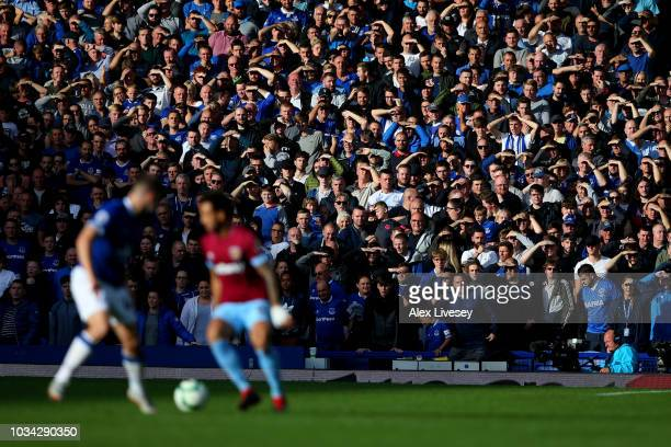 Fans follow the match from the stands during the Premier League match between Everton FC and West Ham United at Goodison Park on September 16 2018 in...